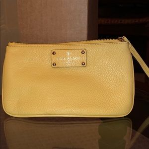 Kate Spade yellow wristlet with strap